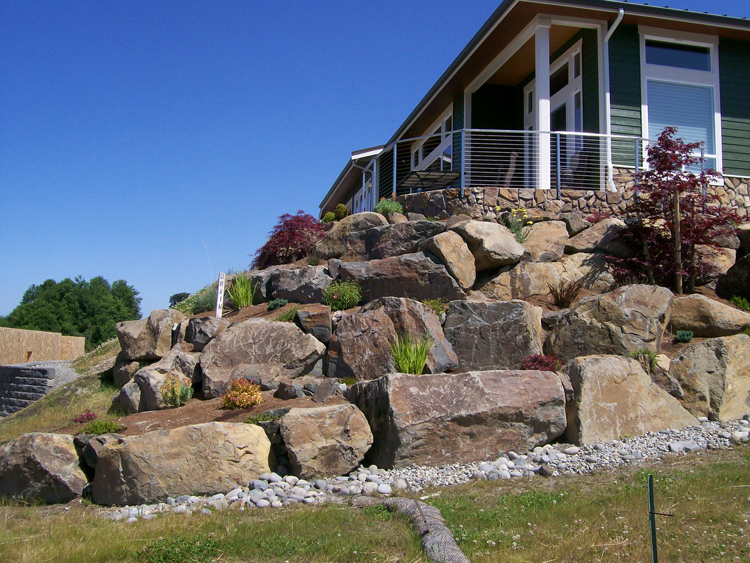 Project gallery fanning company landscape construction for Landscaping rocks on a hill